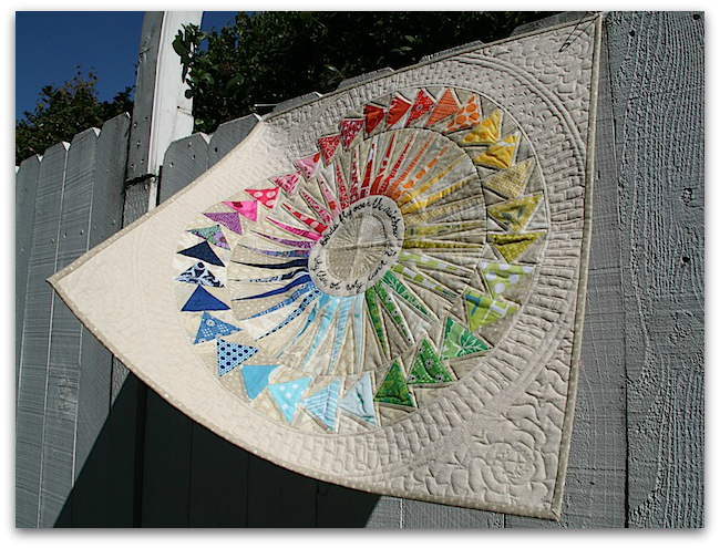 New York Beauty circle of flying geese rainbow quilt