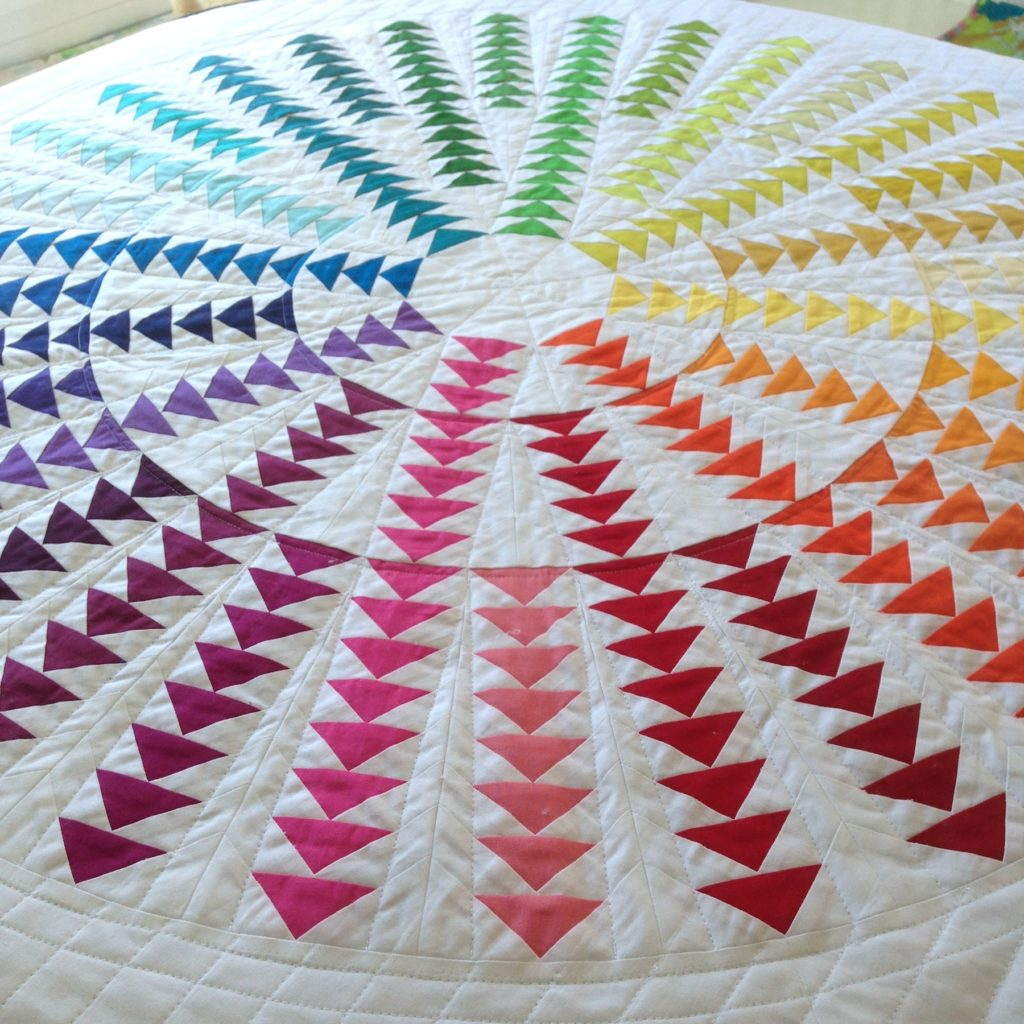 Gaggle of Geese Quilt Pattern, a rainbow circle of flying geese